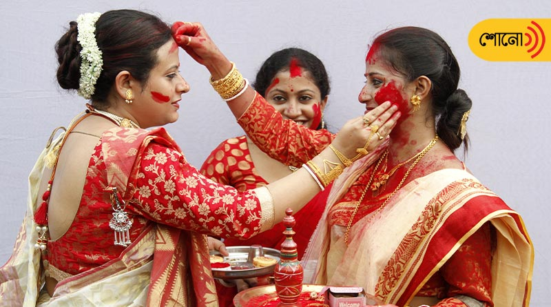 why do married women play with vermilion on Doshomi of Durga Puja